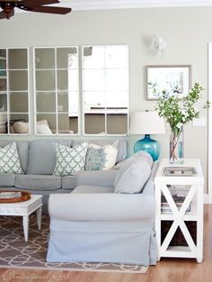 Benjamin Moore's 'Camouflage' a pale gray green. It looks different in morning and evening light, a brighter green in direct sunlight and more gray in evening or indirect sunlight.--kate-family-room.jpg
