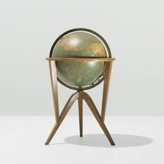 Edward Wormley's Cosmopolitan globe, a 1953 design with bleached mahogany stand.