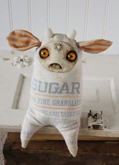 Sugar by Amanda Louise Spayd  Oh no! It's the sugar monster!! And he's so cute. Turn away before your teeth start falling out.