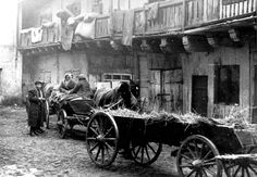 Lublin, Poland, Carts parked in the courtyard of a house in the ghetto. Jewish Ghetto, Warsaw Ghetto, What Is Living, Jewish History, My Heritage, World War Two, Ww2, Poland, Antique Cars