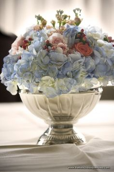 Blue Hydrangea and Peach Roses, Snap and Hypericum Berries in Silver Bowl Centerpiece