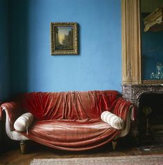 Excerpted from The Right Color by Eve Ashcraft (Artisan Books). A red velvet curtain is tossed casually over a Regency sofa in a room painted a powder blue. Blue Living Room Decor, Living Room Colors, My Living Room, Red Velvet Curtains, Blue Curtains, Blue Rooms, Blue Walls, Chippendale Chairs, Piece A Vivre
