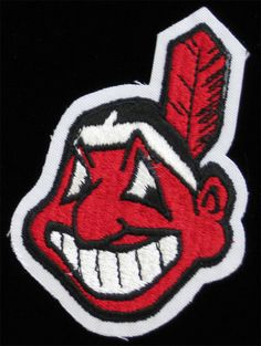 Cleveland Indians Logo Chief Wahoo Swinging A Baseball