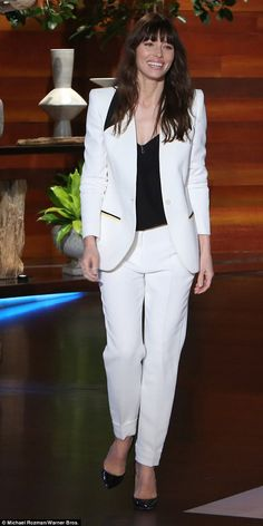 Stylish: Jessica Biel made an appearance on The Ellen DeGeneres Show wearing a crisp white pantsuit with shiny black heels - January 2017