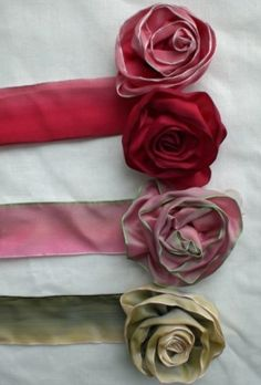 Ribbons and their resulting roses.  Wired ribbon rose tutorial.  This is a spin on the way I've been doing it, I'll have to try this one....