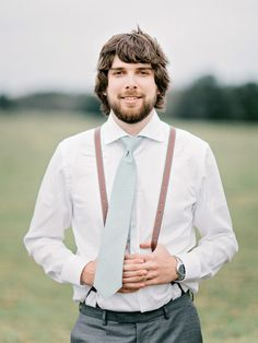 We love when grooms sport unique suspender styles! #groom #suspenders