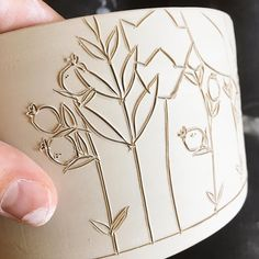 Carving into leather hard pots is such a satisfying step in the process. I also love that each drawing is just a little different.
