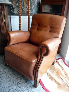 Vintage French leather club chair + studded detail (comfortable style for library, great room, rustic lifestyle).