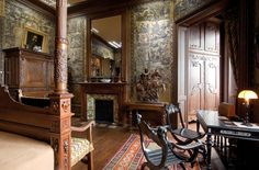 """Mantin House. """"A late 19th-century French mansion (pictured: west facade) shuttered for more than a century has opened its doors to the public, revealing an array of outdated luxuries and oddities."""" This is Mantin's bedroom; the walls are covered in gilded leather. GILDED LEATHER."""
