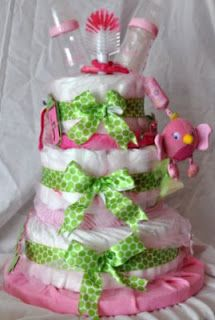 pink and green baby shower decorations | Baby bottles, bottle brush, toys, blankets, diapers, pacifiers and ...