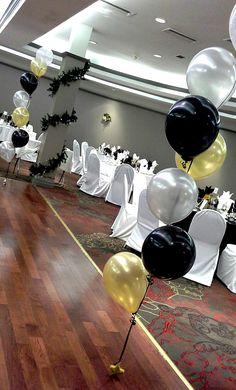 black, gold and silver balloon decor; decor by Davis Floral Creations