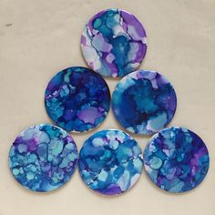 Resin and alcohol ink coasters by @uxhumanoart