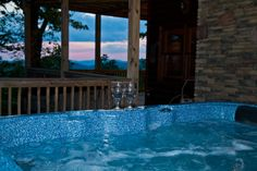 Sunset in the Hot Tub at the luxurious A Bears Lair! www.mtngetawaycabins.com