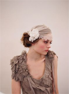 Image from http://wedding-pictures.onewed.com/match/images/17594/vintage-inspired-bridal-headpiece-wedding-cap-veil.original.png.