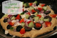 Refreshing Mediterranean Layer Dip. Feta, olives, and hummus make the perfect combination. Great for parties served with pita chips.