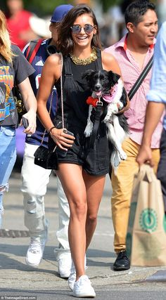 Dog day of summer: Nina Dobrev was seen carrying her pooch in New York City on Sunday...