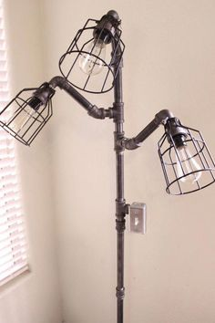 Industrial Floor lamp - Steampunk Black pipe lamp - Free standing lamp, pole lamp with 3 lights - Edison bulbs with cage light guards Diy Floor Lamp, Black Floor Lamp, Arc Floor Lamps, Industrial Floor Lamps, Modern Floor Lamps, Industrial Pipe, Industrial Interiors, Industrial Lighting, Modern Lighting