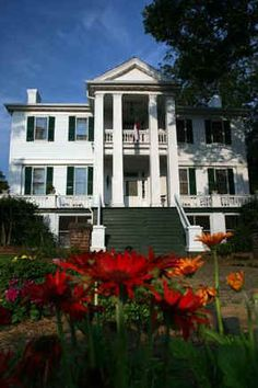 Holly Court Inn:  Washington, GA The home is actually two combined plainstyle Federal period houses that date from the 1830's that have been lovingly restored by the innkeepers. Situated on two lanscaped acres, located just two blocks from the charming town square it is well known as the home where Mrs. Jefferson Davis awaited her husband during his flight south after the fall of Richmond.