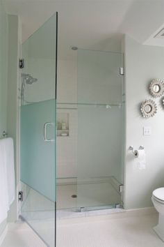 Seaside Home - Coastal Home - Bathroom - Glass Shower Enclosure - White Subway Tile - Glass Accent Tile - Shell Mirror Decor - Pitched Ceiling