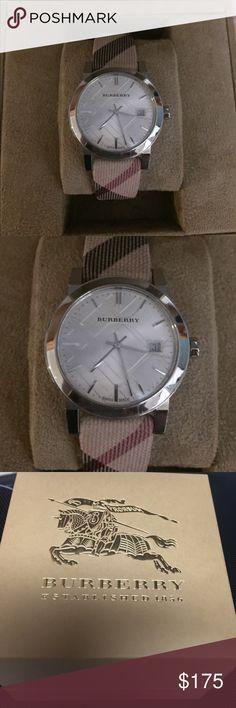 Burberry wrist watch Swiss made sapphire crystal watch with date. In original box Burberry Jewelry