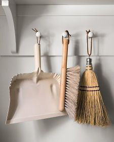 metal dust pans and wooden brooms