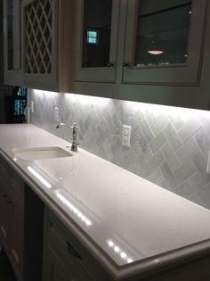 Cararra/Quartz top with white cararra marble subway  tile backsplash