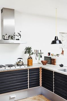 The open kitchen, with stone countertop, is from Uno Form. The tea caddies and ceramics are from Sing Tea House in Copenhagen. How To Install Countertops, Stone Countertops, Kitchen Countertops, New Kitchen, Kitchen Decor, 1950s House, Kitchen Countertop Materials, Best Kitchen Designs, Mid-century Modern