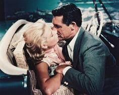 """In her third and final Alfred Hitchcock film, Grace Kelly played opposite Hollywood's suave leading man, Cary Grant. In this scene from the 1955 hit movie, """"To Catch A Thief,"""" Kelly and Grant showcase their on-screen chemistry. Alfred Hitchcock, Hitchcock Film, Cary Grant, Grace Kelly, Hollywood Icons, Classic Hollywood, Old Hollywood, Molly Ringwald, Isla Fisher"""