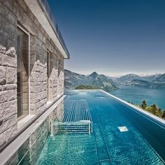 Villa Honegg Located in the Swiss Alps with an outdoor infinity pool that maintains a year-round temperature of Hotel Swimming Pool, Cool Swimming Pools, Best Swimming, Hotel Villa Honegg Switzerland, Lucerne Switzerland, Beautiful Hotels, Beautiful Places, Amazing Hotels, Casa Hotel