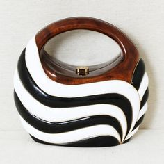 White and black zebra striped acacia wood body and handle bag from Rocio