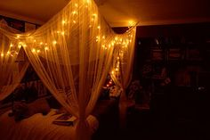 twinkle lights in a bed canopy