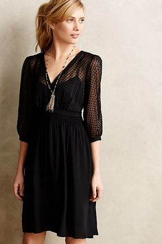 Not sure about the translucent sleeves.  Could look really cute with black tights.  Celeste Dress - anthropologie.com