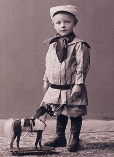 :::::::::: Antique Photograph ::::::::::  Sailor boy with pull toy horse.  ca. 1905
