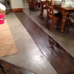 Cement floor with rustic wood inlays (Pottery Barn in Kansas City.)