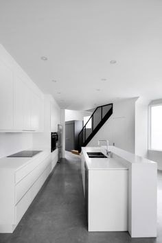 How the island has a panel runs through the top forming the table top.  Architecture & Interior Design - Modern Surfaces