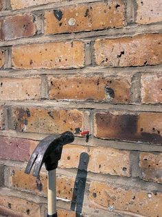 Use Hammer to Knock in Anchor Flush with Brick