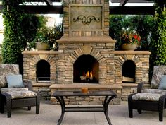 This large outdoor fireplace, with its beautiful stone facade, has a grand allure. With lush greenery peeking from behind the fireplace, this outside space invites you to relax. Photo courtesy of Concrete Network