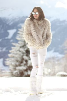 A nude fur jacket and white destroyed slim jeans are a great outfit formula to have in your arsenal. A pair of white snow boots will be a stylish addition to your outfit.  Shop this look for $132:  http://lookastic.com/women/looks/grey-sunglasses-beige-fur-jacket-white-skinny-jeans-white-snow-boots/7902  — Grey Sunglasses  — Beige Fur Jacket  — White Ripped Skinny Jeans  — White Snow Boots