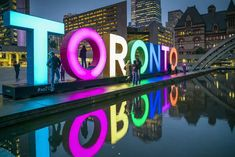 Canada, Ontario, Toronto, Toronto Sign in Nathan Phillips Square by the City Hall, dusk Toronto Vacation, Toronto Travel, Toronto Tourism, Vacation Ideas, Vacation Spots, Toronto Canada, Canada Ontario, Visit Toronto, Stuff To Do