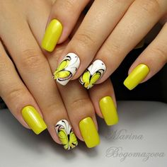 Real Pretty Yellow Nails with Flying Butterfly. Pretty little yellow butterfly flying around the yellow flowers on a bright sunny day. Isn't it fantastic to gaze such a scene? Yup, it is. Create such scene on your nails and you can see it whenever you want.