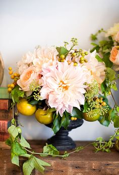 Brides.com: Simple Floral Wedding Centerpieces. Crab Apples and Roses