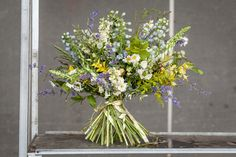 #britishflowersweek #2015 New Covent Garden Flower Market   Wild and loose and overflowing with locally-grown nepeta, delphinium, astrantia, ox-eye daisies, foxgloves, stocks and peonies, offset by the green tones of hornbeam, cotoneaster, a hint of silver eucalyptus, and the yellow pop of euonymous and golden privet.