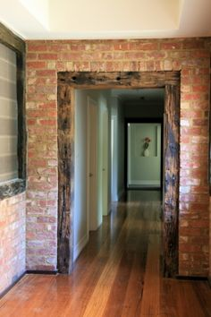 recycled red brick, polished wood floor, exposed timbers, offset with plain white