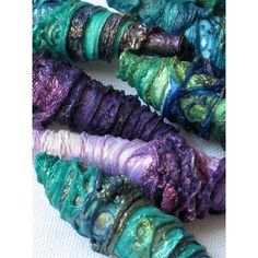 Mixed media textile art beads hand made with Tyvek mermaid colours of purple, mauve, blue, aqua, turquoise green brown gold found on Polyvore