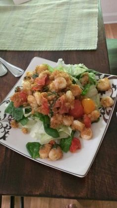 Pan-Seared Shrimp Salads  2 Tbs chopped Basil 1 qt cherry tomatoes, halved 2 lbs cleaned shrimp(I used key west pink small shrimp) 1/2 c breadcrumbs 4 Tbl butter 2 cloves garlic S+p to taste  Melt butter in large Saute Pan. Sear shrimp 3-4 minutes per side. Add tomatoes, garlic, and salt n pepper. Cook another 3 minutes. Remove from heat add breadcrumbs and basil, stir to coat. Serve over salad :-)