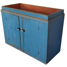 A184 Early 19th century unusual New England Drysink, retaining it's vibrant dry robin egg blue paint, bittersweet red painted well. with plank doors with two chamfered batons, one board square head nail construction. From a private collection in Maine, circa 1820