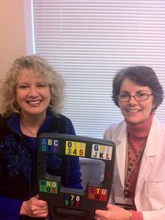 Staff from the Greater Philadelphia Chapter show a reader board that allows people with Lou Gehrig's disease to communicate. Image courtesy of the Greater Philadelphia Chapter and Alisa Brownlee