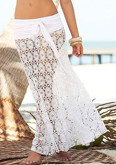 This white crochet maxi skirt is so awesome for it can be worn as a halter neck dress, thanks to its adjustable ties. | Lookbook Store Skirts