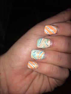 Water marble #firstattempt #kindasloppy #orangenails #aqua #polkadots