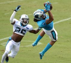 Carolina Panthers wide receiver Kelvin Benjamin, right, catches a pass from quarterback Cam Newton as cornerback Daryl Worley,…